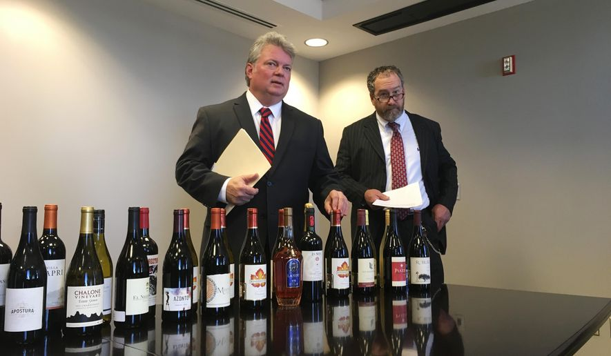 Mississippi Attorney General Jim Hood, left, and Revenue Commissioner Herb Frierson announce lawsuits against wine merchants illegally shipping wine into Mississippi on Thursday, Jan. 25, 2018, in Jackson, Miss. Hood said companies are ignoring the law against shipments to Mississippi and not checking ages of buyers. (AP Photo/Jeff Amy)