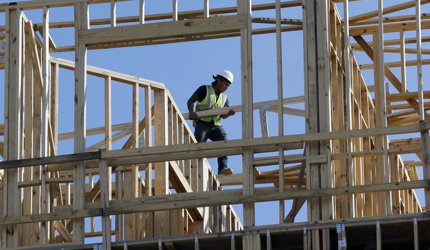 In this Friday, Oct. 6, 2017, file photo, workers build an apartment and retail complex in Nashville, Tenn. On Friday, Jan. 26, 2018, the Commerce Department issued the first estimate of how the U.S. economy performed in the October-December quarter. (AP Photo/Mark Humphrey)