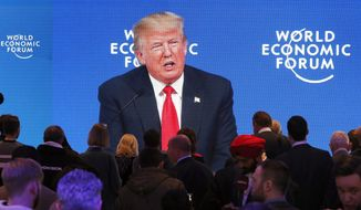 U.S. President Donald Trump's speech is displayed on a video screen during the annual meeting of the World Economic Forum in Davos, Switzerland, Friday, Jan. 26, 2018. (AP Photo/Michael Probst)
