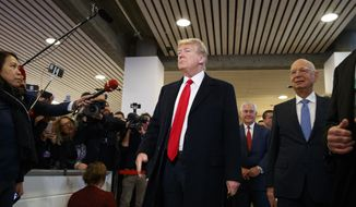 President Donald Trump talks with reporters as he arrives at the World Economic Forum, Friday, Jan. 26, 2018, in Davos. (AP Photo/Evan Vucci)