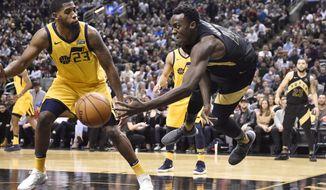 Toronto Raptors forward Pascal Siakam (43) dives to keep the ball next to Utah Jazz forward Royce O'Neale (23) during the second half of an NBA basketball game Friday, Jan. 26, 2018, in Toronto. (Frank Gunn/The Canadian Press via AP)