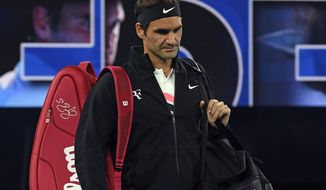 Switzerland's Roger Federer walks onto Rod Laver Arena for his seminal against South Korea's Hyeon Chung at the Australian Open tennis championships in Melbourne, Australia, Friday, Jan. 26, 2018. (AP Photo/Andy Brownbill)