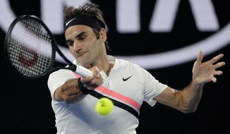Switzerland's Roger Federer makes a forehand return to South Korea's Hyeon Chung during their semifinal at the Australian Open tennis championships in Melbourne, Australia, Friday, Jan. 26, 2018. (AP Photo/Dita Alangkara)