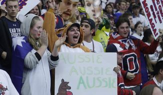 Saint Mary's fans dressed as a koala and a kangaroo cheer before an NCAA college basketball game between Saint Mary's and BYU in Moraga, Calif., Thursday, Jan. 25, 2018, on what was already Australia Day in that country. (AP Photo/Jeff Chiu)