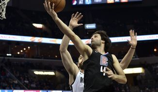 Los Angeles Clippers guard Milos Teodosic (4) shoots against Memphis Grizzlies center Marc Gasol during the first half of an NBA basketball game Friday, Jan. 26, 2018, in Memphis, Tenn. (AP Photo/Brandon Dill)