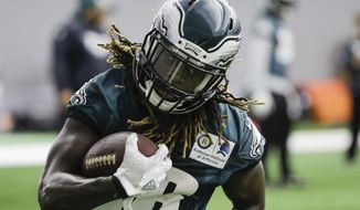 Philadelphia Eagles' Jay Ajayi runs the ball during practice at the team's NFL football training facility in Philadelphia, Friday, Jan. 26, 2018. The Eagles face the New England Patriots in Super Bowl 52 on Sunday, Feb. 4, in Minneapolis. (AP Photo/Matt Rourke)