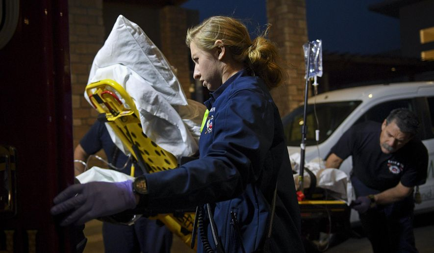 In this Jan. 19, 2018, photo, Lehi firefighter and paramedic Aubrey Freiberg helps fellow firefighters load a patient into an ambulance after they responded to a medical call at Pointe Meadows Health and Rehabilitation in Lehi, Utah. (Isaac Hale/The Daily Herald via AP)