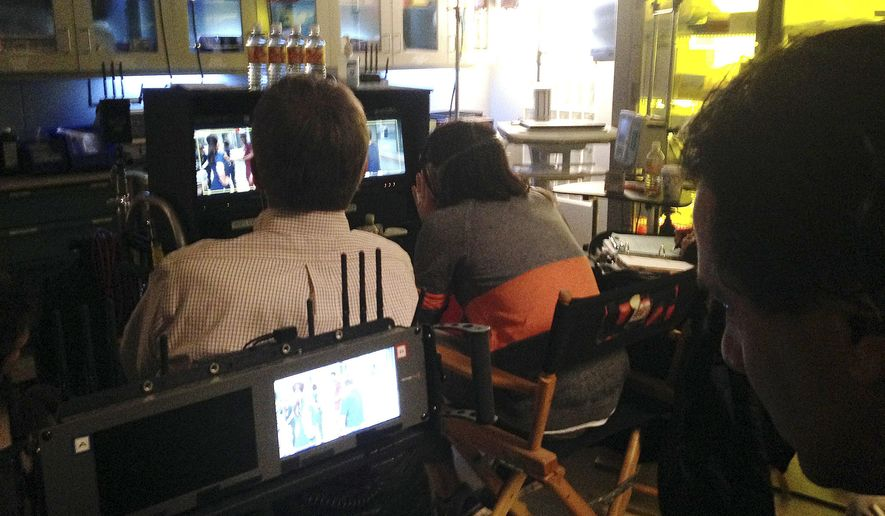 """FILE - In this Feb. 19, 2015 file photo, crew from NBC's """"The Night Shift,"""" watch over filming of an episode at Albuquerque Studios in Albuquerque, N.M. Democratic state lawmakers want to eliminate New Mexico's annual $50 million cap on film incentive spending but the future of the proposal is unclear. A bill eliminating the cap is moving through the New Mexico House and comes after state officials reported the film and television industry contributed more than a half-billion dollars to New Mexico's economy in 2016. (AP Photo/Russell Contreras, file)"""