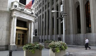 FILE - In this Monday, Aug. 24, 2015, file photo, a man walks towards the New York Stock Exchange. U.S. stocks are rising early Friday, Jan. 26, 2018, as technology and health care companies make continued gains. (AP Photo/Seth Wenig, File)