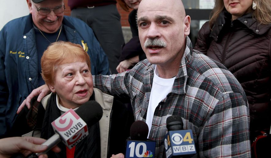 FILE - In this Feb. 10, 2016 file photo, George Perrot, right, with his mother Beverly Garrant, talks to the media in front of the Bristol County Superior Court after he was released following his bail hearing in New Bedford, Mass. His stepfather Robert Garrant is at left. On Thursday, Jan. 25, 2018, Perrot, who spent three decades in prison for a rape he said he did not commit, sued law enforcement officers and agencies he alleges conspired to frame him. (Jonathan Wiggs/The Boston Globe via AP, File)