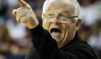 FILE - In this March 18, 2016, file photo, Chattanooga head coach Jim Foster yells during a first-round women's college basketball game against Mississippi State in the NCAA Tournament in Starkville, Miss. Foster's next win will be the 900th of his college coaching career, tying the Women's Basketball Hall of Famer with former Texas coach Jody Conradt for seventh all-time. He is 899-341 in 40 seasons as a college head coach at St. Joseph's, Vanderbilt, Ohio State and Chattanooga. (AP Photo/Rogelio V. Solis, File)