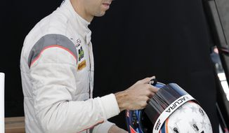 Ricky Taylor removes his helmet after taking a turn driving during practice for the IMSA 24-hour auto race at Daytona International Speedway, Friday, Jan. 26, 2018, in Daytona Beach, Fla. (AP Photo/John Raoux)