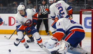 New York Islanders center Mathew Barzal (13) takes control of the puck against the Vegas Golden Knights during the second period of an NHL hockey game Thursday, Jan. 25, 2018, in Las Vegas. (AP Photo/L.E. Baskow)