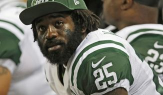 FILE- In this Nov. 18, 2012, file photo, New York Jets' Joe McKnight (25) sits on the sideline during the fourth quarter of an NFL football game against the St. Louis Rams in St. Louis. Closing argument are expected Friday, Jan. 26, 2018 in the murder trial of Ronald Gasser, who is accused of killing Knight in a road rage incident. (AP Photo/Tom Gannam, File)