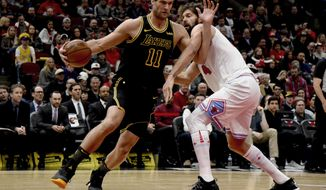 Los Angeles Lakers center Brook Lopez (11) drives to the basket against Chicago Bulls forward Nikola Mirotic during the first half of an NBA basketball game Friday, Jan. 26, 2018, in Chicago. (AP Photo/Matt Marton)