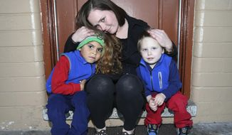 In a Friday, Jan. 19, 2018 photo, Kelsey Still poses for a photo with her sons, Grayson Perry, 6, left, and Riley Still, 2, at a hotel where she has been living on South Pine Avenue in Ocala, Fla. Last year as a result of a domestic violence situation, her children ended up in DCF care. In September her husband committed suicide, which caused a tremendous financial hardship for her and her 2 children. The family has been living in a motel, paying $290 a week and struggling to survive. She walks at least 10 miles a day so she can get her 2 children to daycare and get to work. With a lot of hard work, she has regained custody of her children and CWAH paid the majority of the security deposit and first month rent ($1,200) to help her move into an apartment at Regency Properties. She will be moving in February 1. [Bruce Ackerman/Star-Banner via AP)