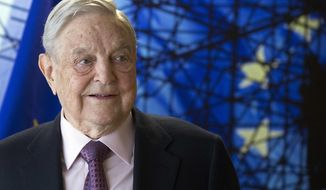 FILE - This Thursday, April 27, 2017 file photo shows George Soros, Founder and Chairman of the Open Society Foundation, before the start of a meeting at EU headquarters in Brussels. On Friday, Jan. 26, 2018, The Associated Press has found that stories circulating on the internet about Soros paying three Democrats millions of dollars to vote for a government shutdown are untrue. (Olivier Hoslet, Pool Photo, File, via AP)