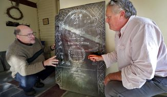 FILE- In this Dec. 1, 2017 file photo Walter Skold, left, and gravestone carver Michael Updike discuss the design of Skold's future tombstone, in Newbury, Mass. Skold suffered a heart attack and died in Elkins Park, Pa., on Saturday, Jan. 20, 2018, where he had recently moved after residing in Freeport, Maine. Skold drew inspiration from his visits to the graves of more than 600 poets for his own tombstone to be carved by the son of novelist John Updike. (AP Photo/Robert F. Bukaty, File)