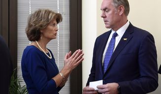 File - In this Jan. 22, 2018, file photo, Sen. Lisa Murkowski, R-Alaska, left, talks with Interior Secretary Ryan Zinke, right, before an event in her office on Capitol Hill in Washington. Alaska's pro-development congressional delegation is asking the Trump administration to back off from offering nearly all lands off the state's coast for petroleum leases. In a letter Friday, Jan. 26, 2018, to Zinke, Alaska Senators Murkowski and Dan Sullivan and Rep. Don Young say Cook Inlet, where petroleum extraction now occurs, and Arctic waters should be offered in lease sale plans. (AP Photo/Susan Walsh, File)