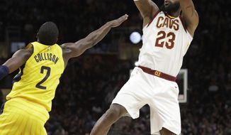 Cleveland Cavaliers' LeBron James (23) shoots over Indiana Pacers' Darren Collison (2) during the first half of an NBA basketball game Friday, Jan. 26, 2018, in Cleveland. (AP Photo/Tony Dejak)