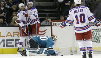 New York Rangers' Ryan McDonagh, top left, is hugged by teammate Kevin Hayes (13) after McDonagh's goal against the San Jose Sharks during the second period of an NHL hockey game Thursday, Jan. 25, 2018, in San Jose, Calif. (AP Photo/Marcio Jose Sanchez)