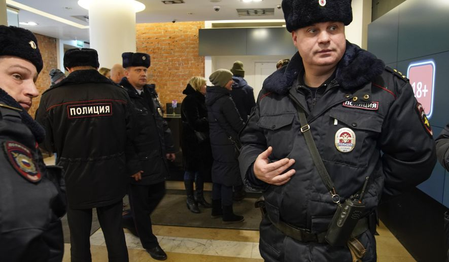 "Russian police visit the Pioner movie theater in Moscow, Russia, Friday, Jan. 26, 2018. Pioner movie theater has been showing Scottish writer-director Armando Iannucci's ""The Death of Stalin"" since Thursday despite the Russian Culture Ministry's decision to rescind the permit for screening it. Police didn't declare the purpose of their visit to the theater Friday. (AP Photo/Alexander Zemlianichenko)"
