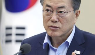 In this photo provided by South Korea Presidential Blue House through Yonhap News Agency, South Korean President Moon Jae-in speaks about a fire during a meeting at the presidential Blue House in Seoul, South Korea, Friday, Jan. 26, 2018. A fire swept through a hospital for the elderly in southeastern South Korea on Friday, killing more than 30 people and injuring dozens in one of the country's deadliest fires in recent years. (South Korea Presidential Blue House/Yonhap via AP)