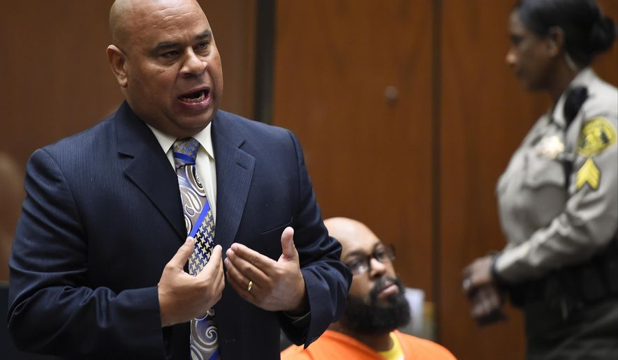 "FILE - In this March 20, 2015 file photo, Attorney Matthew Fletcher, left, speaks for his client, Marion ""Suge"" Knight, right, in a court appearance for a bail review hearing in his murder case in Los Angeles. Authorities say the high-profile Los Angeles attorney, Fletcher, has been arrested. Los Angeles County sheriff's spokeswoman Nicole Nishida tells The Associated Press that Matthew Fletcher was arrested on a warrant Thursday, Jan. 25, 2018. (AP Photo/Robyn Beck, Pool, File)"