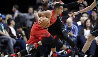 Portland Trail Blazers guard CJ McCollum (3) works against Dallas Mavericks guard Wesley Matthews, rear, during the first half of an NBA basketball game Friday, Jan. 26, 2018, in Dallas. (AP Photo/Tony Gutierrez)