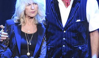Honorees Christine McVie, left, and Mick Fleetwood of Fleetwood Mac stand with their awards onstage at the 2018 MusiCares Person of the Year tribute honoring Fleetwood Mac at Radio City Music Hall on Friday, Jan. 26, 2018, in New York. (Photo by Evan Agostini/Invision/AP)