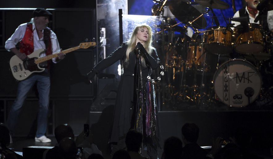 Honorees John McVie, from left, Stevie Nicks and Mick Fleetwood of Fleetwood Mac perform onstage at the 2018 MusiCares Person of the Year tribute honoring Fleetwood Mac at Radio City Music Hall on Friday, Jan. 26, 2018, in New York. (Photo by Evan Agostini/Invision/AP)