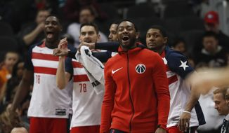 Washington Wizards guard John Wall (2) cheers from the bench in the second half of an NBA basketball game against the Atlanta Hawks Saturday, Jan. 27, 2018, in Atlanta. Washington won 129-104 (AP Photo/John Bazemore)