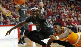 Iowa State forward Solomon Young, left, fights for a loose ball with Tennessee forward Kyle Alexander, right, during the first half of an NCAA college basketball game, Saturday, Jan. 27, 2018, in Ames, Iowa. (AP Photo/Charlie Neibergall)