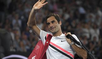Switzerland's Roger Federer waves as he leaves Rod Laver Arena following South Korea's Hyeon Chung's retirement from their semifinal at the Australian Open tennis championships in Melbourne, Australia, Friday, Jan. 26, 2018.(AP Photo/Andy Brownbill)