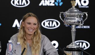 Denmark's Caroline Wozniacki smiles at a press conference with her trophy after defeating Romania's Simona Halep in the women's singles final at the Australian Open tennis championships in Melbourne, Australia, Sunday, Jan. 28, 2018. (AP Photo/Vincent Thian) ** FILE **