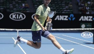 United States' Sebastian Korda celebrates with a scissor kick after defeating Taiwan's Tseng Chun Hsin in the boy's singles final at the Australian Open tennis championships in Melbourne, Australia, Saturday, Jan. 27, 2018. (AP Photo/Dita Alangkara)