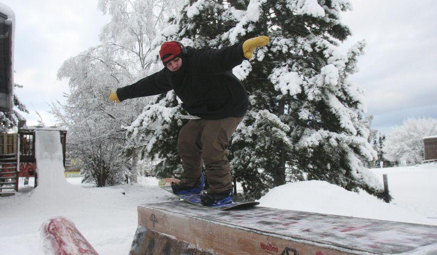 15, 2018 Photo, Josh Martinez Snowboards Over A Box