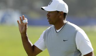 Tiger Woods reacts after making a putt on the 12th hole of the South Course at Torrey Pines Golf Course during the third round of the Farmers Insurance Open golf tournament, Saturday, Jan. 27, 2018, in San Diego. (AP Photo/Gregory Bull)
