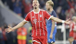 Bayern's Sandro Wagner celebrates after scoring his fifth's fourth goal during the German Soccer Bundesliga match between FC Bayern Munich and TSG 1899 Hoffenheim in Munich, Germany, Saturday, Jan. 27, 2018. (AP Photo/Matthias Schrader)