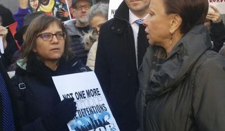 U.S. Rep. Nydia Velazquez addresses Amy Gottlieb, left, the wife of detained immigrant rights activist Ravi Ragbir during a demonstration in front of the Manhattan office building that houses Immigration and Customs Enforcement, Saturday, Jan. 27, 2018 in New York. Velazquez has invited Gottlieb to President Donald Trump's State of the Union address on Tuesday, Jan. 30. (AP Photo/Julie Walker)