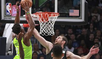 Brooklyn Nets center Tyler Zeller (44) fouls Minnesota Timberwolves guard Jimmy Butler (23) in the first quarter of an NBA basketball game Saturday, Jan. 27, 2018, in Minneapolis. (AP Photo/Andy Clayton-King)