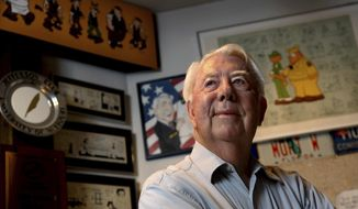 FILE - In this Aug. 16, 2010 file photo, Mort Walker, the artist and author of the Beetle Bailey comic strip, stands in his studio in Stamford, Conn. On Saturday, Jan. 27, 2018, a family member said the comic strip artist has died. He was 94. (AP Photo/Craig Ruttle)