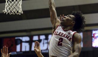Alabama guard Collin Sexton (2) puts up a shot over Oklahoma center Jamuni McNeace (4) during the second half of an NCAA college basketball game, Saturday, Jan. 27, 2018, in Tuscaloosa, Ala. Alabama won 80-73. (AP Photo/Butch Dill)