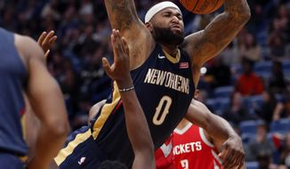 New Orleans Pelicans center DeMarcus Cousins (0) loses the ball as he commits an offensive foul against Houston Rockets center Clint Capela (15) while driving to the basket during the second half of an NBA basketball game in New Orleans, Friday, Jan. 26, 2018. The Pelicans won 115-113. (AP Photo/Gerald Herbert)