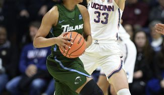 Connecticut's Katie Lou Samuelson (33) guards Tulane's Kolby Morgan (3) in the first half of an NCAA college basketball game Saturday, Jan. 27, 2018, in Storrs, Conn. (AP Photo/Stephen Dunn)