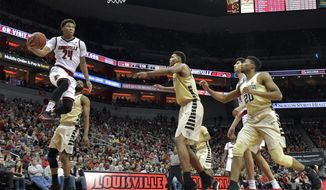 Louisville forward Dwayne Sutton (24) drives in for a layup past the Wake Forest defense during the second half of an NCAA college basketball game Saturday, Jan. 27, 2018, in Louisville, Ky. Louisville won 96-77. (AP Photo/Timothy D. Easley)