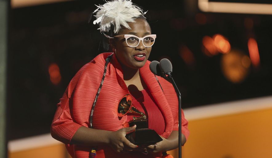 """Cecile McLorin Salvant accepts the best jazz vocal album award for """"Dreams And Daggers"""" at the 60th annual Grammy Awards at Madison Square Garden on Sunday, Jan. 28, 2018, in New York. (Photo by Matt Sayles/Invision/AP)"""