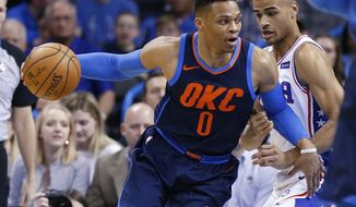 Oklahoma City Thunder guard Russell Westbrook (0) drives around Philadelphia 76ers guard Timothe Luwawu-Cabarrot, right, in the first half of an NBA basketball game in Oklahoma City, Sunday, Jan. 28, 2018. (AP Photo/Sue Ogrocki)