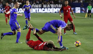United States midfielder Gyasi Zardes, bottom, falls to the ground after he was pushed by Bosnia and Herzegovina defender Daniel Graovac during the first half of an international friendly soccer match on Sunday, Jan. 28, 2018, in Carson, Calif. (AP Photo/Jae C. Hong)