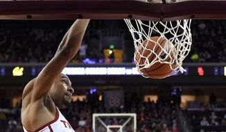 Southern California guard Jordan McLaughlin dunks during the second half of an NCAA college basketball game against California, Sunday, Jan. 28, 2018, in Los Angeles. USC won 77-59. (AP Photo/Mark J. Terrill)